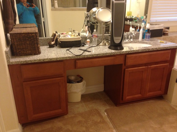 Bathroom vanity before refinishing in Cypress, TX