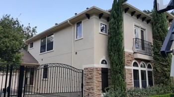 Exterior Painting of Stucco, Staining and Wrought-iron Fences in Spring Branch, TX
